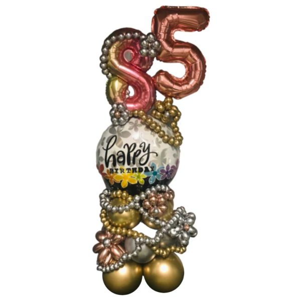 Gold and Silver bead balloons adorn this happy birthday balloon tower