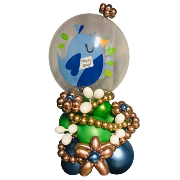 Happy Day balloon arrangement with flowers and beads and a big clear balloon on top with a bird printed on it
